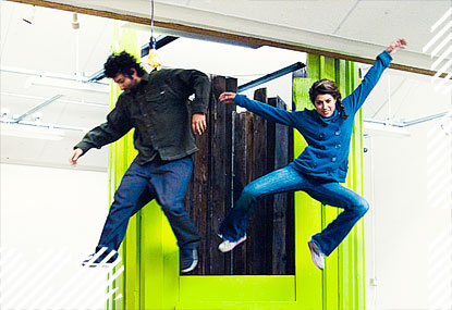 Studio environment with leaping students in mid-air